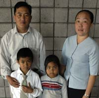 Hmong family: father, mother, son and daughter