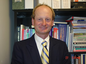 Dr. Chris Tennant